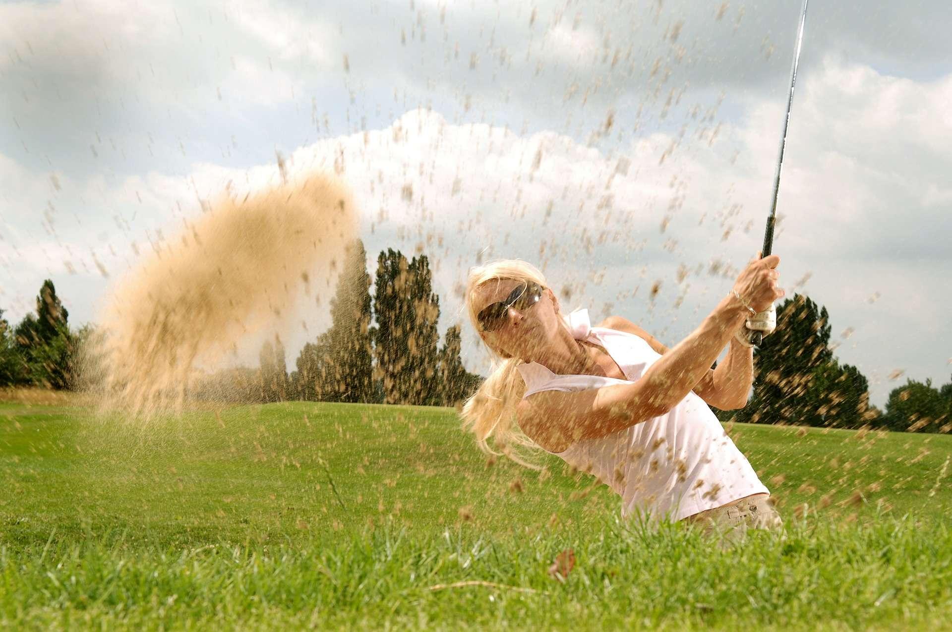woman golfing